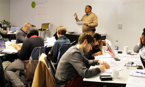 Man teaching students from front of a room